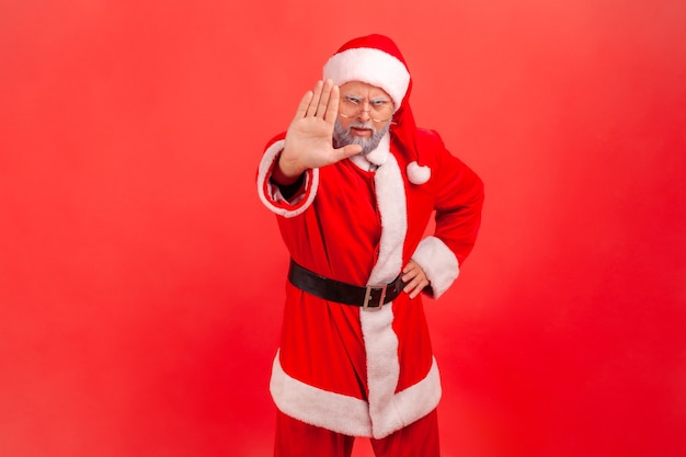Santa claus showing stop ban gesture with palm, sign of prohibition, with hand.
