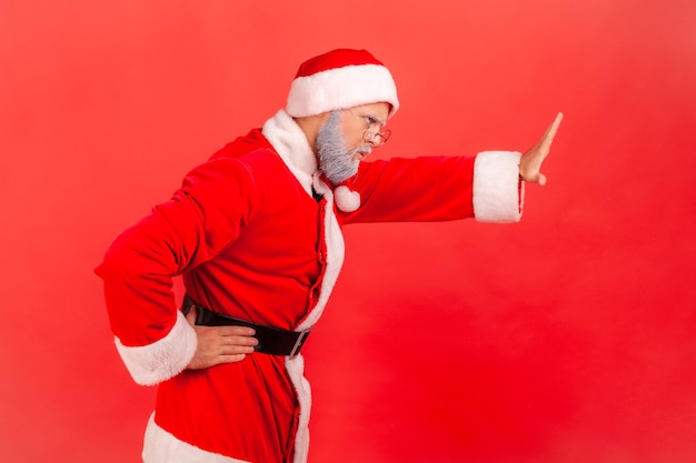 Santa claus showing stop sign with outstretched hands, warning expression with negative gesture.