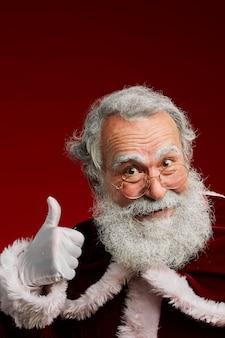 Santa claus showing thumbs up