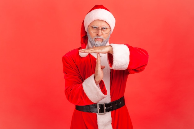 Santa claus showing time out gesture, stop or limit hand sign, warning of deadline.