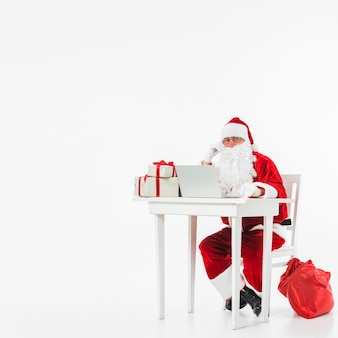 Santa claus sitting on chair with sack