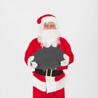 Santa Claus standing and holding blackboard