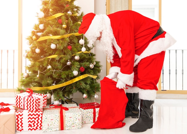 Santa claus taking out presents from bag