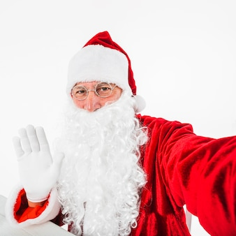 Santa claus taking selfie with smartphone