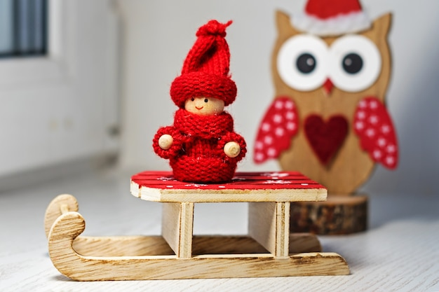 Santa claus toy sleigh and a christmas owl