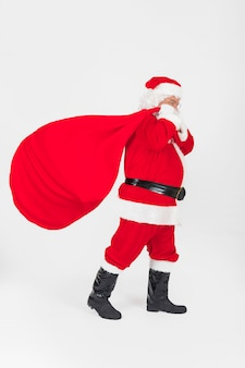 Santa claus walking with sack of presents