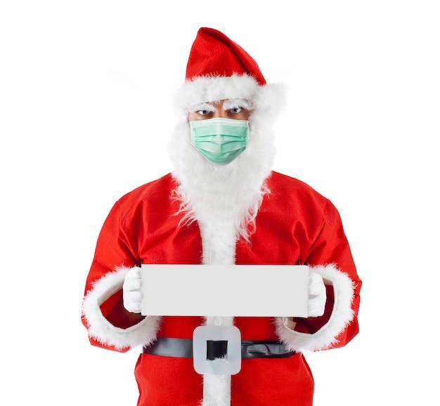 サンタクロースの魔女のサージカルマスクと空白の看板