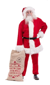 Дед мороз с подарочной сумкой, вырезанной на белой поверхности