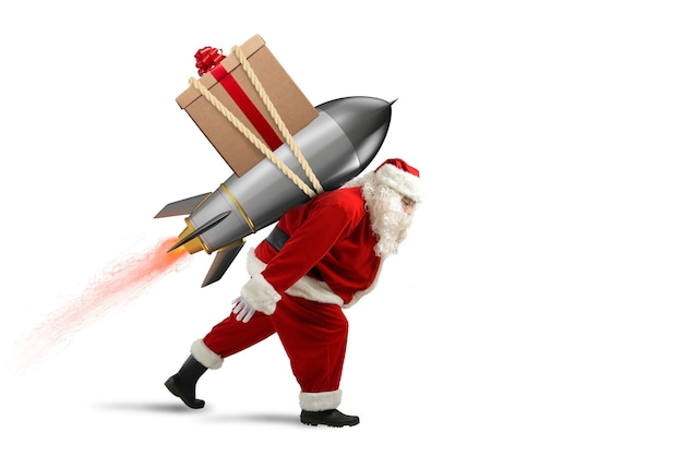 Santa claus with christmas gift box ready to fly with a rocket in the sky