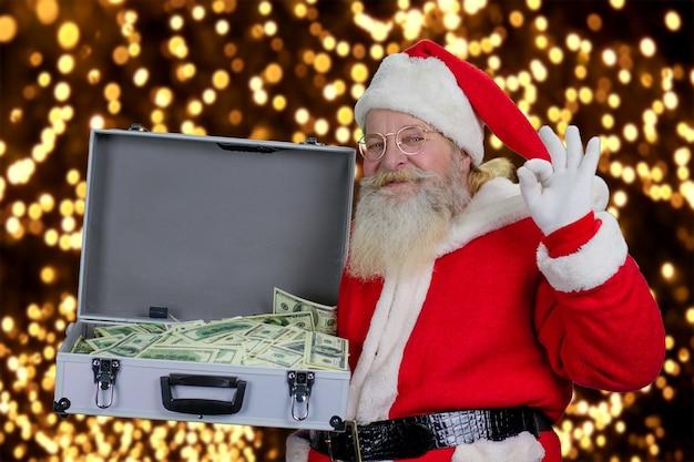 Дед мороз с полным ящиком долларов.