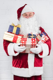 Santa claus with gifts in hands