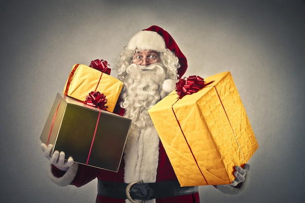 Santa claus with lot of gifts