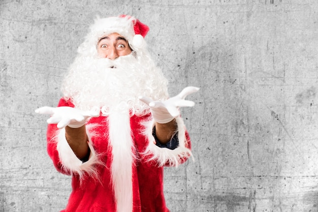 Santa claus with open hands and white gloves