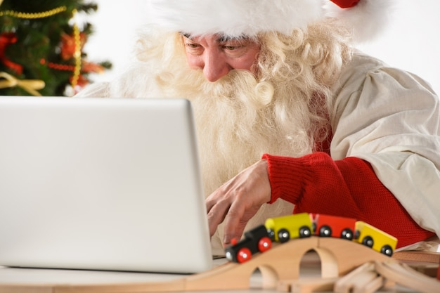 Santa claus with real beard using laptop