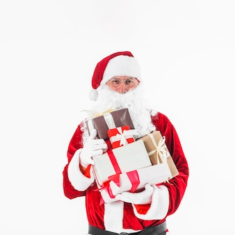 Santa claus with various gift boxes in hands