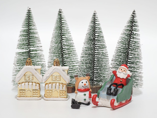 Santa clause sitting on sleigh with with snowman waiting for christmas