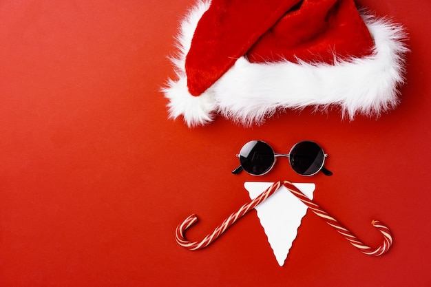 Santa face made of paper and sunglasses