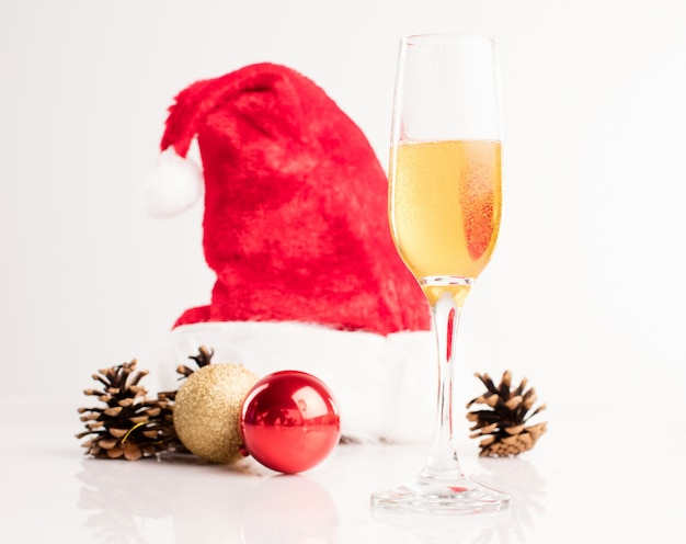Santa hat with a glass of champagne