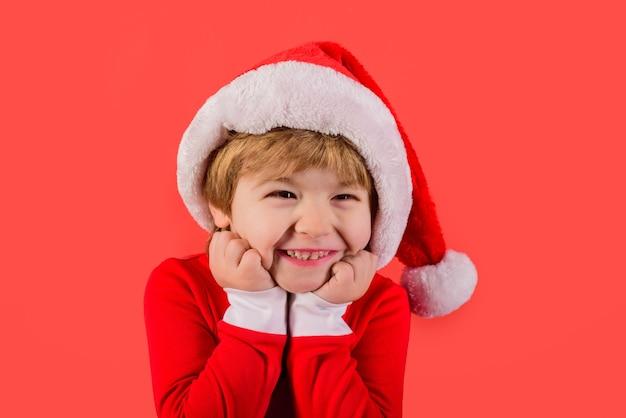 Santa helper elf smiling kid in santa costume santa claus gifts new year christmas kids holiday kid