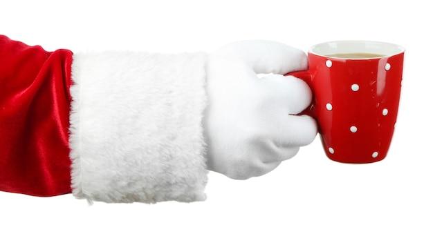 マグカップを手に持って、白で隔離のサンタ