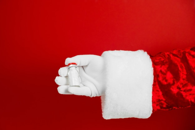 Santa holds bottle with antidote