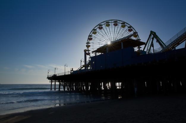 Santa moica pier ferris wheel at sunset in california
