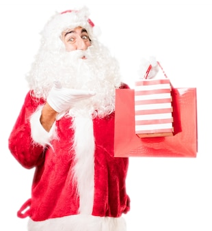 Santa pointing two red bags