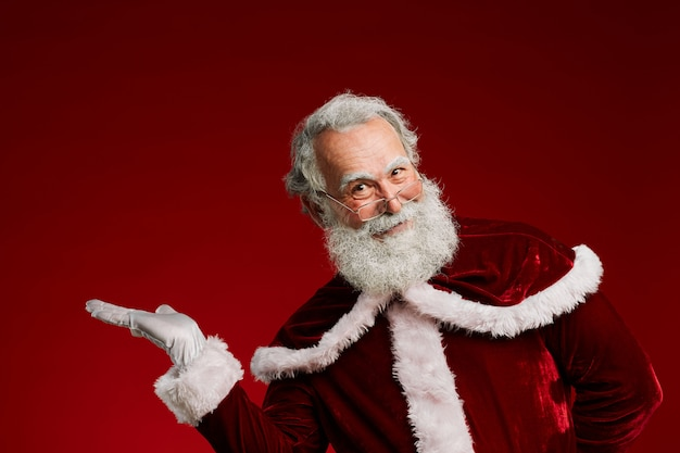Santa presenting on red