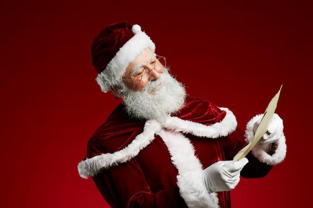 Santa reading list against red