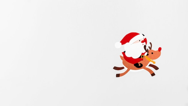Santa riding reindeer rudolph copy space