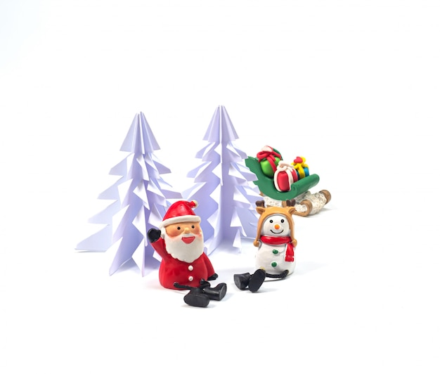 Santa and snow man sat in front of origami christmas tree , with sleighl full of gists waiting for the festival of happiness