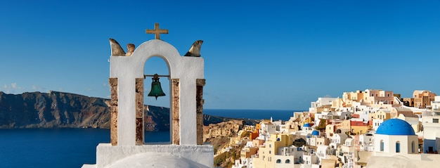 Santorini in greece - traditional belfry and architecture of oia, panorama