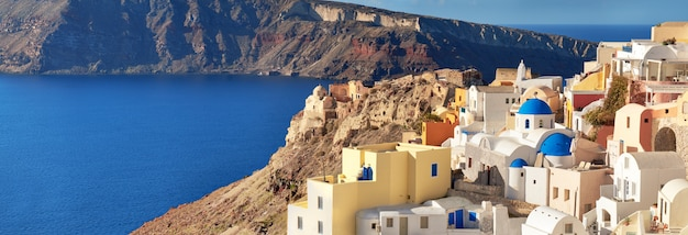 Santorini in greece - traditional church and architecture of oia, panorama