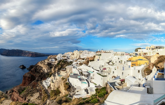 Santorini island in greece, oia village under dramatic sky