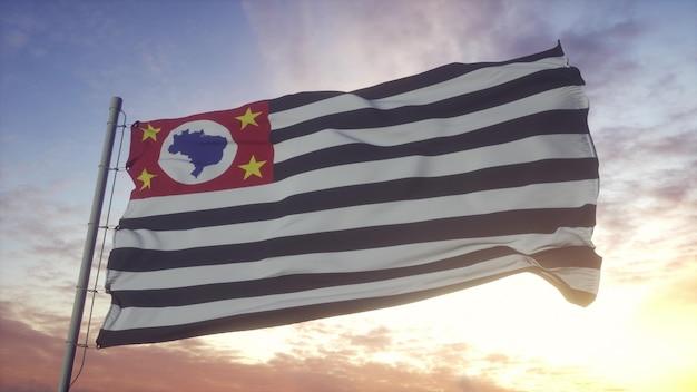 風、空、太陽の背景に手を振るサンパウロ州旗。 3dレンダリング