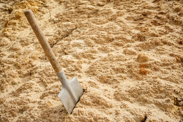 Sapper shovel in dry sand