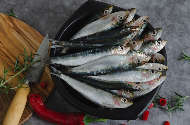Sardines in a ceramic bowl on a marble table