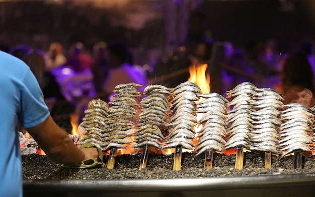 Sardines to the fire on the beach
