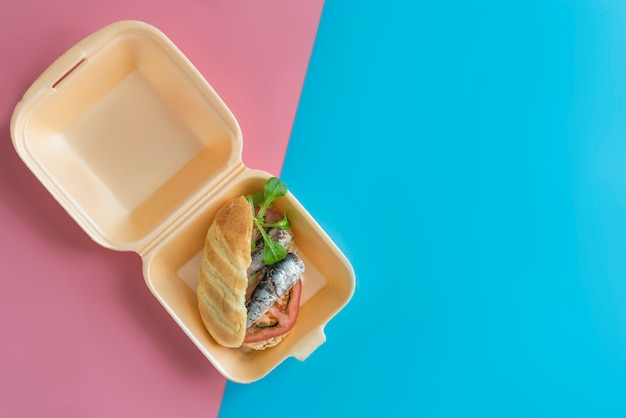 Sardines sandwich with tomato, lettuce, pepper,