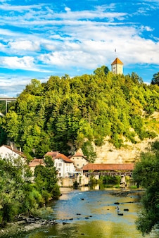The sarine river with covered bridge of bern in fribourg, switzerland