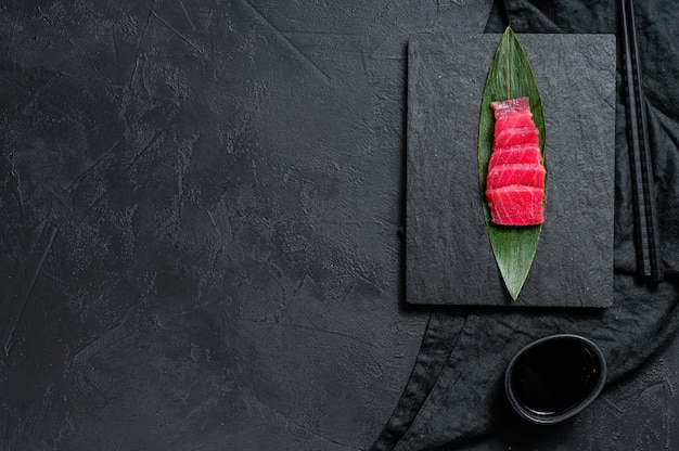 Sashimi tuna on a stone board. top view. copyspace background
