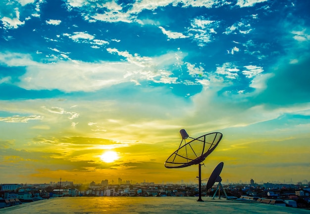 Satelite dishes with sunset