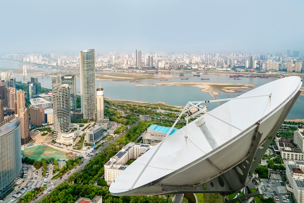 A satellite dish above the city