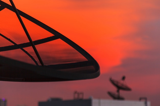 Satellite dish at twilight sky in the city