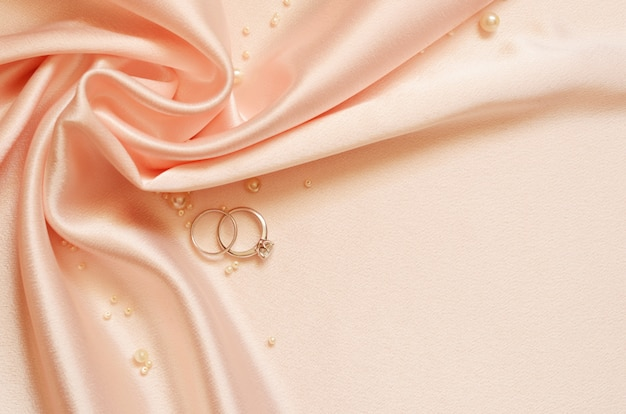 Satin drapery with pearls and wedding rings