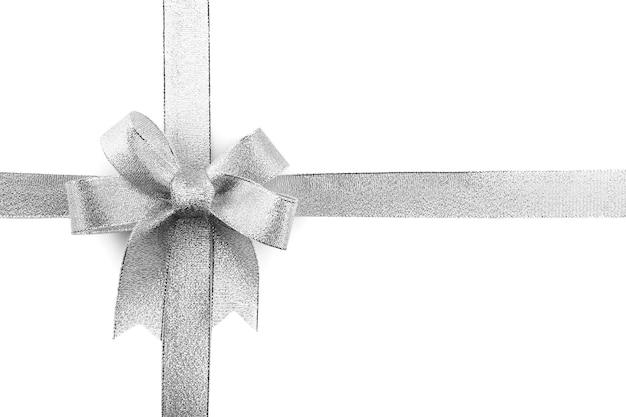 白で隔離のサテンリボンの弓