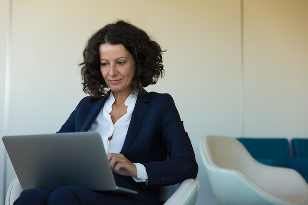 Satisfied businesswoman working on computer