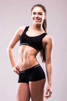 Satisfied confident active healthy woman in sports clothing with hands on hips
