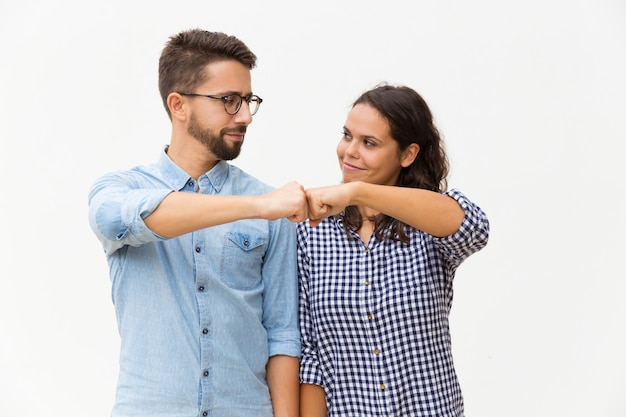 Satisfied couple making fist bump gesture