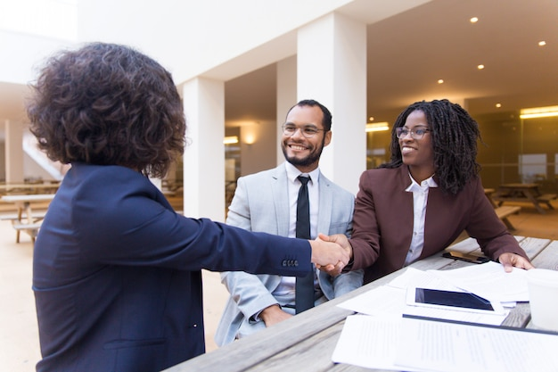 Satisfied customers thanking professional for help